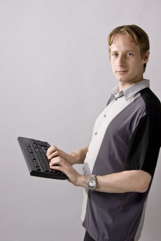 Michael Kubler holding a magic hovering keyboard